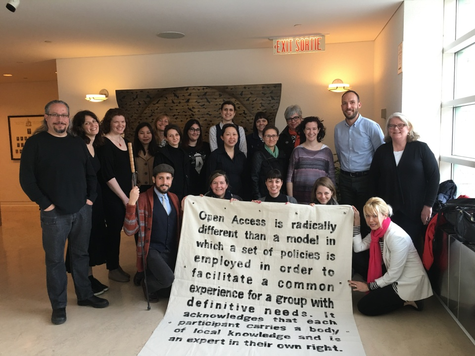 A group photo from Ottawa - where Carmen and a group of participants are holding an Open Access banner